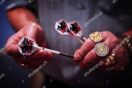 The hands of 2007 champion Martin 'Wolfie' Adams at The World Darts Championship at The Lakeside Complex, Frimley Green, Surrey, Britain