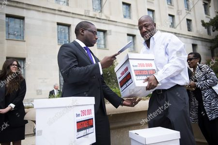 Stock Photo of Justice Department Press Secretary Kevin Lewis (l) Accepts Boxes That Represent Petition Signatures Outside the Us Department of Justice During a Black Lives Matter Protest in Washington Dc Usa 26 August 2015 Activists Held a Rally to Hand-deliver 260 000 Signatures to the Office of Attorney General Loretta Lynch Demanding a Federal Investigation Into the Arrest and Death of Sandra Bland United States Washington