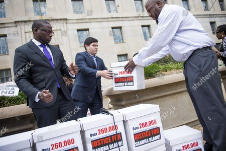 Justice Department Press Secretary Kevin Lewis (l) with a Public Affairs Staff Member Accepts Boxes That Represent Petition Signatures Outside the Us Department of Justice During a Black Lives Matter Protest in Washington Dc Usa 26 August 2015 Activists Held a Rally to Hand-deliver 260 000 Signatures to the Office of Attorney General Loretta Lynch Demanding a Federal Investigation Into the Arrest and Death of Sandra Bland United States Washington