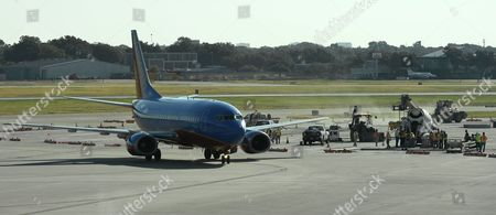 A Southwest Plane Taxis Past the Work Area where a Bronze Marker Will Be Placed Indicating the Location where Vice President Lyndon B Johnson Took the Oath of Office to Become President at Love Field Airport Will Be Installed in Dallas Texas Usa 03 September 2015 Lyndon B Johnson Became the Thirty Sixth President of the United States After John F Kennedy was Assassinated in Dallas Texas United States Dallas