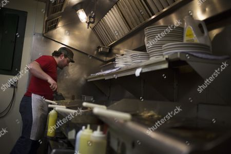 Undecided Voter and Chef Adam Brown Prepares Breakfast in the Kitchen at Home Plate Diner a Popular Spot For Politicians in Des Moines Iowa 27 January 2016 the First Votes in the State-by-state Primary Process to Choose the Presidential Candidate For Each Party Will Be Cast in the Iowa Caucuses on February 1 United States Des Moines