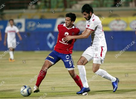 Al-zamalek Player Ali Gabr (r)) Fights For the Ball with Al-ahly Player Amr Gamal (l) During Their Egyptian League Soccer Soccer Match at Military Stadium in Suez Egypt 10 July 2016 Al-ahly Won the Egyptian League 2016 Egypt Suez