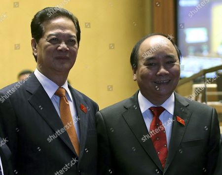 Vietnam's Former Prime Minister Nguyen Tan Dung (l) Poses For Pictures Next to New Prime Minister Nguyen Xuan Phuc (r) in Hanoi Vietnam 07 April 2016 According to Reports Nguyen Xuan Phuc 61 Former Deputy Prime Minister was Approved by 446 of 490 Legislators As the New Prime Minister on 07 April 2016 Viet Nam Hanoi