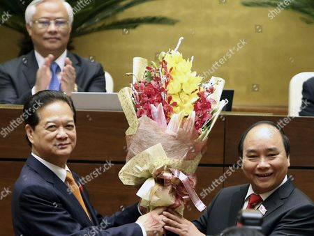 Vietnam's Former Prime Minister Nguyen Tan Dung (l) Congratulates New Prime Minister Nguyen Xuan Phuc (r) During Phuc's Taking Oath of Office Following His Election by Vietnam's Parliament in Hanoi Vietnam 07 April 2016 According to Reports Nguyen Xuan Phuc 61 Former Deputy Prime Minister was Approved by 446 of 490 Legislators As the New Prime Minister on 07 April 2016 Viet Nam Hanoi
