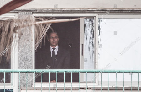 Stock Picture of Gamal Mubarak looking from the window at Maadi military hospital in Cairo, Egypt, 02 March 2017, before the begining of the trial of his father, Hosni Mubarak, Egyptian former President, for allegedly conspiring to kill protesters during the 2011 uprising, that ended his 30-year rule.