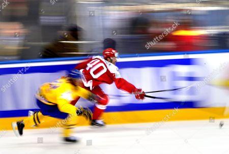 Jesper Christensen (r) of Denmark in Action Against Magnus Nygren (l) of Sweden During the Ice Hockey World Championship Match Denmark Vs Sweden at the Chizhovka Arena in Minsk Belarus 10 May 2014 Belarus Minsk