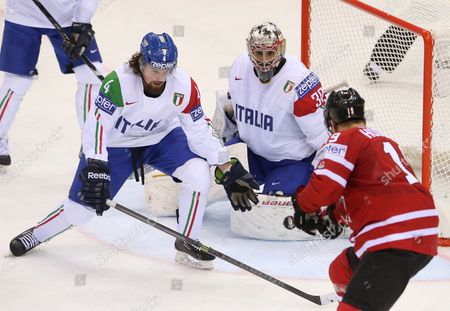 Daniel Sullivan (l) and Daniel Bellissimo (c) of Italy in Action Against Cody Hodgson (r) of Canada As He Scores a Goal During the Ice Hockey World Championship Canada Vs Italy in the Chizhovka Arena in Minsk Belarus 16 May 2014 Belarus Minsk