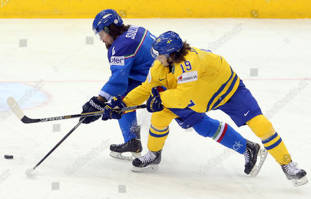 Daniel Sullivan (l) of Italy in Action Against Calle Jarnkrok (r) of Sweden During the Ice Hockey World Championship Match Between Italy and Sweden in the Chizhovka Arena in Minsk Belarus 19 May 2014 Belarus Minsk