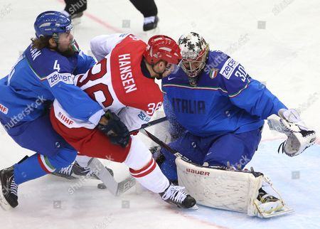 Daniel Sullivan (l) and Goalkeeper Daniel Bellissimo (r) of Italy in Action Against Jannik Hansen (c) of Denmark During the Ice Hockey World Championship Between Italy and Denmark at the Chizhovka Arena in Minsk Belarus 13 May 2014 Belarus Minsk