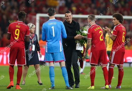 Stock Photo of Daniel Van Buyten (c) is Honored by His Former Teammates Before the Friendly Soccer Match Between Belgium and Australia at the Maurice Dufrasne Stadium in Liege Belgium 04 September 2014 Daniel Van Buyten Announced His Retirement From Professional Football in August Belgium Liege