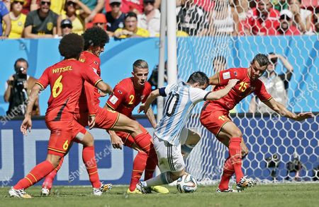Argentina's Lionel Messi (2-r) is Challenged by Four Belgium's Axel Witsel (l-r) Marouane Fellaini Toby Alderweireld and Daniel Van Buyten During the Fifa World Cup 2014 Quarter Final Match Between Argentina and Belgium at the Estadio Nacional in Brasilia Brazil 05 July 2014 (restrictions Apply: Editorial Use Only not Used in Association with Any Commercial Entity - Images Must not Be Used in Any Form of Alert Service Or Push Service of Any Kind Including Via Mobile Alert Services Downloads to Mobile Devices Or Mms Messaging - Images Must Appear As Still Images and Must not Emulate Match Action Video Footage - No Alteration is Made to and No Text Or Image is Superimposed Over Any Published Image Which: (a) Intentionally Obscures Or Removes a Sponsor Identification Image; Or (b) Adds Or Overlays the Commercial Identification of Any Third Party Which is not Officially Associated with the Fifa World Cup) Brazil Brasilia