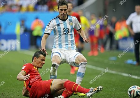 Belgium's Daniel Van Buyten (l) and Argentina's Jose Maria Basanta (r) Vie For the Ball During the Fifa World Cup 2014 Quarter Final Match Between Argentina and Belgium at the Estadio Nacional in Brasilia Brazil 05 July 2014 (restrictions Apply: Editorial Use Only not Used in Association with Any Commercial Entity - Images Must not Be Used in Any Form of Alert Service Or Push Service of Any Kind Including Via Mobile Alert Services Downloads to Mobile Devices Or Mms Messaging - Images Must Appear As Still Images and Must not Emulate Match Action Video Footage - No Alteration is Made to and No Text Or Image is Superimposed Over Any Published Image Which: (a) Intentionally Obscures Or Removes a Sponsor Identification Image; Or (b) Adds Or Overlays the Commercial Identification of Any Third Party Which is not Officially Associated with the Fifa World Cup) Brazil Brasilia