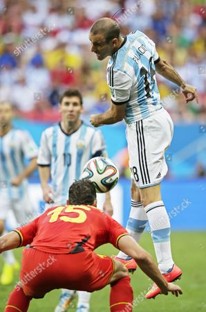 Belgium's Daniel Van Buyten (l) and Argentina's Rodrigo Palacio (r) Vie For the Ball During the Fifa World Cup 2014 Quarter Final Match Between Argentina and Belgium at the Estadio Nacional in Brasilia Brazil 05 July 2014 (restrictions Apply: Editorial Use Only not Used in Association with Any Commercial Entity - Images Must not Be Used in Any Form of Alert Service Or Push Service of Any Kind Including Via Mobile Alert Services Downloads to Mobile Devices Or Mms Messaging - Images Must Appear As Still Images and Must not Emulate Match Action Video Footage - No Alteration is Made to and No Text Or Image is Superimposed Over Any Published Image Which: (a) Intentionally Obscures Or Removes a Sponsor Identification Image; Or (b) Adds Or Overlays the Commercial Identification of Any Third Party Which is not Officially Associated with the Fifa World Cup) Brazil Brasilia