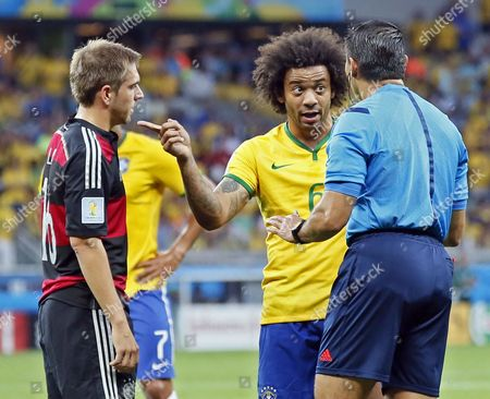 Germany's Philipp Lahm (l) Brazil's Marcelo (c) and Mexican Referee Marco Rodriguez (r) Talk to Each Other During the Fifa World Cup 2014 Semi Final Match Between Brazil and Germany at the Estadio Mineirao in Belo Horizonte Brazil 08 July 2014 (restrictions Apply: Editorial Use Only not Used in Association with Any Commercial Entity - Images Must not Be Used in Any Form of Alert Service Or Push Service of Any Kind Including Via Mobile Alert Services Downloads to Mobile Devices Or Mms Messaging - Images Must Appear As Still Images and Must not Emulate Match Action Video Footage - No Alteration is Made to and No Text Or Image is Superimposed Over Any Published Image Which: (a) Intentionally Obscures Or Removes a Sponsor Identification Image; Or (b) Adds Or Overlays the Commercial Identification of Any Third Party Which is not Officially Associated with the Fifa World Cup) Brazil Belo Horizonte
