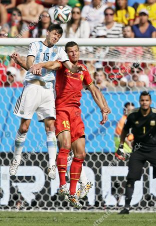 Argentina's Martin Demichelis (l) and Belgium's Daniel Van Buyten (r) Vie For the Ball During the Fifa World Cup 2014 Quarter Final Match Between Argentina and Belgium at the Estadio Nacional in Brasilia Brazil 05 July 2014 (restrictions Apply: Editorial Use Only not Used in Association with Any Commercial Entity - Images Must not Be Used in Any Form of Alert Service Or Push Service of Any Kind Including Via Mobile Alert Services Downloads to Mobile Devices Or Mms Messaging - Images Must Appear As Still Images and Must not Emulate Match Action Video Footage - No Alteration is Made to and No Text Or Image is Superimposed Over Any Published Image Which: (a) Intentionally Obscures Or Removes a Sponsor Identification Image; Or (b) Adds Or Overlays the Commercial Identification of Any Third Party Which is not Officially Associated with the Fifa World Cup) Brazil Brasilia