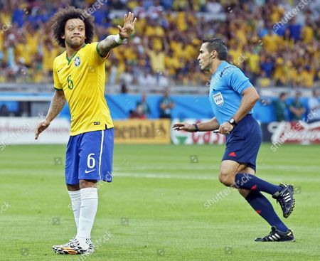 Brazil's Marcelo (l) Gestures Next to Mexican Referee Marco Rodriguez (r) During the Fifa World Cup 2014 Semi Final Match Between Brazil and Germany at the Estadio Mineirao in Belo Horizonte Brazil 08 July 2014 (restrictions Apply: Editorial Use Only not Used in Association with Any Commercial Entity - Images Must not Be Used in Any Form of Alert Service Or Push Service of Any Kind Including Via Mobile Alert Services Downloads to Mobile Devices Or Mms Messaging - Images Must Appear As Still Images and Must not Emulate Match Action Video Footage - No Alteration is Made to and No Text Or Image is Superimposed Over Any Published Image Which: (a) Intentionally Obscures Or Removes a Sponsor Identification Image; Or (b) Adds Or Overlays the Commercial Identification of Any Third Party Which is not Officially Associated with the Fifa World Cup) Brazil Belo Horizonte