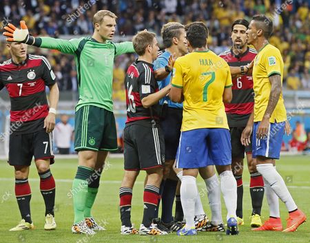 Germany's Goalkeeper Manuel Neuer (l-r) Philipp Lahm Mexican Referee Marco Rodriguez Brazil's Hulk Germany's Sami Khedira and Brazil's Luiz Gustavo Exchange Opinions During the Fifa World Cup 2014 Semi Final Match Between Brazil and Germany at the Estadio Mineirao in Belo Horizonte Brazil 08 July 2014 (restrictions Apply: Editorial Use Only not Used in Association with Any Commercial Entity - Images Must not Be Used in Any Form of Alert Service Or Push Service of Any Kind Including Via Mobile Alert Services Downloads to Mobile Devices Or Mms Messaging - Images Must Appear As Still Images and Must not Emulate Match Action Video Footage - No Alteration is Made to and No Text Or Image is Superimposed Over Any Published Image Which: (a) Intentionally Obscures Or Removes a Sponsor Identification Image; Or (b) Adds Or Overlays the Commercial Identification of Any Third Party Which is not Officially Associated with the Fifa World Cup) Brazil Belo Horizonte