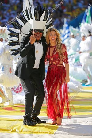 Brazilian Musician Carlinhos Brown (l) and Colombian Singer Shakira (r) Perform During the Closing Ceremony Prior to the Fifa World Cup 2014 Final Between Germany and Argentina at the Estadio Do Maracana in Rio De Janeiro Brazil 13 July 2014 (restrictions Apply: Editorial Use Only not Used in Association with Any Commercial Entity - Images Must not Be Used in Any Form of Alert Service Or Push Service of Any Kind Including Via Mobile Alert Services Downloads to Mobile Devices Or Mms Messaging - Images Must Appear As Still Images and Must not Emulate Match Action Video Footage - No Alteration is Made to and No Text Or Image is Superimposed Over Any Published Image Which: (a) Intentionally Obscures Or Removes a Sponsor Identification Image; Or (b) Adds Or Overlays the Commercial Identification of Any Third Party Which is not Officially Associated with the Fifa World Cup) Brazil Rio De Janeiro
