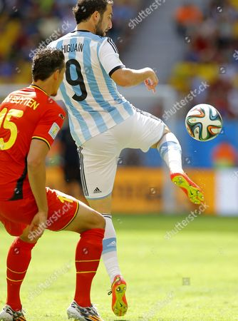 Daniel Van Buyten (l) of Belgium in Action with Gonzalo Higuain of Argentina During the Fifa World Cup 2014 Quarter Final Match Between Argentina and Belgium at the Estadio Nacional in Brasilia Brazil 05 July 2014 (restrictions Apply: Editorial Use Only not Used in Association with Any Commercial Entity - Images Must not Be Used in Any Form of Alert Service Or Push Service of Any Kind Including Via Mobile Alert Services Downloads to Mobile Devices Or Mms Messaging - Images Must Appear As Still Images and Must not Emulate Match Action Video Footage - No Alteration is Made to and No Text Or Image is Superimposed Over Any Published Image Which: (a) Intentionally Obscures Or Removes a Sponsor Identification Image; Or (b) Adds Or Overlays the Commercial Identification of Any Third Party Which is not Officially Associated with the Fifa World Cup) Brazil Brasilia