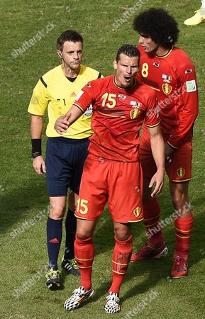 Daniel Van Buyten (c) of Belgium Reacts Next to Italian Referee Nicola Rizzoli (l) During the Fifa World Cup 2014 Quarter Final Match Between Argentina and Belgium at the Estadio Nacional in Brasilia Brazil 05 July 2014 Argentina Won 1-0 (restrictions Apply: Editorial Use Only not Used in Association with Any Commercial Entity - Images Must not Be Used in Any Form of Alert Service Or Push Service of Any Kind Including Via Mobile Alert Services Downloads to Mobile Devices Or Mms Messaging - Images Must Appear As Still Images and Must not Emulate Match Action Video Footage - No Alteration is Made to and No Text Or Image is Superimposed Over Any Published Image Which: (a) Intentionally Obscures Or Removes a Sponsor Identification Image; Or (b) Adds Or Overlays the Commercial Identification of Any Third Party Which is not Officially Associated with the Fifa World Cup) Brazil Brasilia
