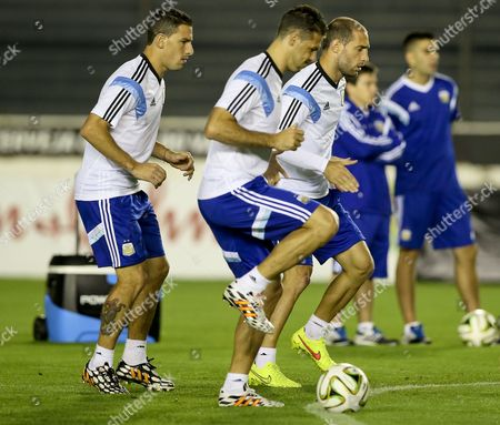 Argentina National Soccer Team Players Maxi Rodriguez (l) Martin Demichelis (c) and Pablo Zabaleta (r) During a Training Session of the Argentina National Soccer Team at the Estadio Vasco Da Gama in Rio De Janeiro Brazil 12 July 2014 Argentina Will Face Germany in the Fifa World Cup 2014 Final on 13 July 2014 in Rio De Janeiro Brazil Rio De Janeiro