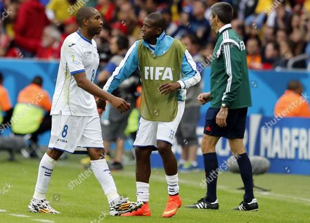Wilson Palacios (l) of Honduras Leaves the Pitch After a Yellow-red Card During the Fifa World Cup 2014 Group E Preliminary Round Match Between France and Honduras at the Estadio Beira-rio in Porto Alegre Brazil 15 June 2014 (restrictions Apply: Editorial Use Only not Used in Association with Any Commercial Entity - Images Must not Be Used in Any Form of Alert Service Or Push Service of Any Kind Including Via Mobile Alert Services Downloads to Mobile Devices Or Mms Messaging - Images Must Appear As Still Images and Must not Emulate Match Action Video Footage - No Alteration is Made to and No Text Or Image is Superimposed Over Any Published Image Which: (a) Intentionally Obscures Or Removes a Sponsor Identification Image; Or (b) Adds Or Overlays the Commercial Identification of Any Third Party Which is not Officially Associated with the Fifa World Cup) Brazil Porto Alegre