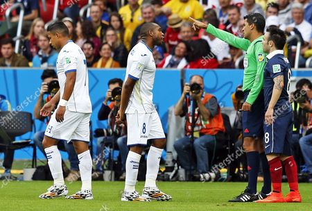 Brazilian Referee Sandro Ricci (r) Talks to Emilio Izaguirre (l) and Wilson Palacios (2-l) As France's Mathieu Valbuena (r) Listens During the Fifa World Cup 2014 Group E Preliminary Round Match Between France and Honduras at the Estadio Beira-rio in Porto Alegre Brazil 15 June 2014 (restrictions Apply: Editorial Use Only not Used in Association with Any Commercial Entity - Images Must not Be Used in Any Form of Alert Service Or Push Service of Any Kind Including Via Mobile Alert Services Downloads to Mobile Devices Or Mms Messaging - Images Must Appear As Still Images and Must not Emulate Match Action Video Footage - No Alteration is Made to and No Text Or Image is Superimposed Over Any Published Image Which: (a) Intentionally Obscures Or Removes a Sponsor Identification Image; Or (b) Adds Or Overlays the Commercial Identification of Any Third Party Which is not Officially Associated with the Fifa World Cup) Brazil Porto Alegre