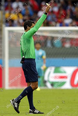 Brazilian Referee Sandro Ricci Shows the Yellow Card to Wilson Palacios of Honduras (not Pictured) During the Fifa World Cup 2014 Group E Preliminary Round Match Between France and Honduras at the Estadio Beira-rio in Porto Alegre Brazil 15 June 2014 (restrictions Apply: Editorial Use Only not Used in Association with Any Commercial Entity - Images Must not Be Used in Any Form of Alert Service Or Push Service of Any Kind Including Via Mobile Alert Services Downloads to Mobile Devices Or Mms Messaging - Images Must Appear As Still Images and Must not Emulate Match Action Video Footage - No Alteration is Made to and No Text Or Image is Superimposed Over Any Published Image Which: (a) Intentionally Obscures Or Removes a Sponsor Identification Image; Or (b) Adds Or Overlays the Commercial Identification of Any Third Party Which is not Officially Associated with the Fifa World Cup) Brazil Porto Alegre