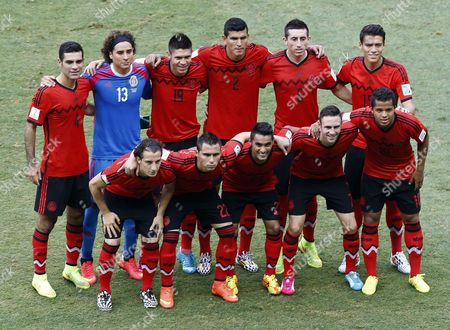 Mexico's Starting Eleven (top L-r) Rafael Marquez Guillermo Ochoa Oribe Peralta Francisco Maza Rodriguez Hector Herrera Hector Morena (bottom L-r) Andres Guardado Paul Aguilar Jose Vazquez Miguel Layun and Giovani Dos Santos Line Up For the Group Photo Prior the Fifa World Cup 2014 Group a Preliminary Round Match Between Brazil and Mexico at the Estadio Castelao in Fortaleza Brazil 17 June 2014 (restrictions Apply: Editorial Use Only not Used in Association with Any Commercial Entity - Images Must not Be Used in Any Form of Alert Service Or Push Service of Any Kind Including Via Mobile Alert Services Downloads to Mobile Devices Or Mms Messaging - Images Must Appear As Still Images and Must not Emulate Match Action Video Footage - No Alteration is Made to and No Text Or Image is Superimposed Over Any Published Image Which: (a) Intentionally Obscures Or Removes a Sponsor Identification Image; Or (b) Adds Or Overlays the Commercial Identification of Any Third Party Which is not Officially Associated with the Fifa World Cup) Brazil Fortaleza