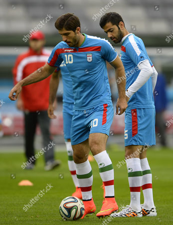 Iran National Soccer Team Player Karim Ansari Fard (l) Trains with Pejman Montazeri (r) During the Training Session at the Arena Da Baixada in Curitiba Parana Brazil 15 June 2014 Iran Will Face Nigeria in Their First Match of the World Cup 2014 in Curitiba Brazil on 16 June 2014 (restrictions Apply: Editorial Use Only not Used in Association with Any Commercial Entity - Images Must not Be Used in Any Form of Alert Service Or Push Service of Any Kind Including Via Mobile Alert Services Downloads to Mobile Devices Or Mms Messaging - Images Must Appear As Still Images and Must not Emulate Match Action Video Footage - No Alteration is Made to and No Text Or Image is Superimposed Over Any Published Image Which: (a) Intentionally Obscures Or Removes a Sponsor Identification Image; Or (b) Adds Or Overlays the Commercial Identification of Any Third Party Which is not Officially Associated with the Fifa World Cup) Brazil Curitiba