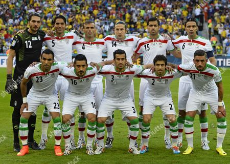 Iran's Starting Eleven (top L-r) Goalie Alireza Haghighi Amirhossein Sadeghi Jalal Hosseini Andranik Timotian Pejman Montazeri Javad Nekounam (bottom (l-r) Mehrdad Pooladi Reza Ghoochannejad Ehsan Haji Safi Khosro Heydari and Ashkan Dejagah Pose Fo Rth Egroup Photo Prior the Fifa World Cup 2014 Group F Preliminary Round Match Between Iran and Nigeria at the Arena Da Baixada in Curitiba Brazil 16 June 2014 (restrictions Apply: Editorial Use Only not Used in Association with Any Commercial Entity - Images Must not Be Used in Any Form of Alert Service Or Push Service of Any Kind Including Via Mobile Alert Services Downloads to Mobile Devices Or Mms Messaging - Images Must Appear As Still Images and Must not Emulate Match Action Video Footage - No Alteration is Made to and No Text Or Image is Superimposed Over Any Published Image Which: (a) Intentionally Obscures Or Removes a Sponsor Identification Image; Or (b) Adds Or Overlays the Commercial Identification of Any Third Party Which is not Officially Associated with the Fifa World Cup) Brazil Curitiba