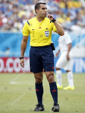 Mexican Referee Marco Rodriguez Blows the Whistle During the Fifa World Cup 2014 Group D Preliminary Round Match Between Italy and Uruguay at the Estadio Arena Das Dunas in Natal Brazil 24 June 2014 (restrictions Apply: Editorial Use Only not Used in Association with Any Commercial Entity - Images Must not Be Used in Any Form of Alert Service Or Push Service of Any Kind Including Via Mobile Alert Services Downloads to Mobile Devices Or Mms Messaging - Images Must Appear As Still Images and Must not Emulate Match Action Video Footage - No Alteration is Made to and No Text Or Image is Superimposed Over Any Published Image Which: (a) Intentionally Obscures Or Removes a Sponsor Identification Image; Or (b) Adds Or Overlays the Commercial Identification of Any Third Party Which is not Officially Associated with the Fifa World Cup) Brazil Natal
