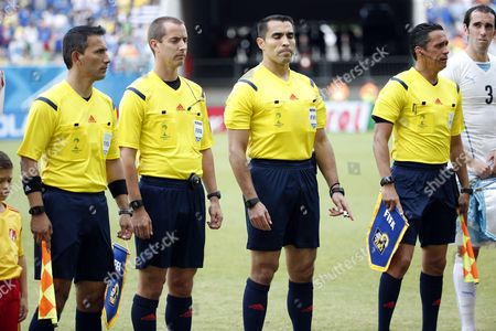 Mexican Referee Marco Rodriguez (2-r) His Compatriot Assistants Marvin Torrentera (r) and Marcos Quintero and Fourth Official Mark W Geiger of Usa (2-l) Line Up Prior the Fifa World Cup 2014 Group D Preliminary Round Match Between Italy and Uruguay at the Estadio Arena Das Dunas in Natal Brazil 24 June 2014 (restrictions Apply: Editorial Use Only not Used in Association with Any Commercial Entity - Images Must not Be Used in Any Form of Alert Service Or Push Service of Any Kind Including Via Mobile Alert Services Downloads to Mobile Devices Or Mms Messaging - Images Must Appear As Still Images and Must not Emulate Match Action Video Footage - No Alteration is Made to and No Text Or Image is Superimposed Over Any Published Image Which: (a) Intentionally Obscures Or Removes a Sponsor Identification Image; Or (b) Adds Or Overlays the Commercial Identification of Any Third Party Which is not Officially Associated with the Fifa World Cup) Brazil Natal