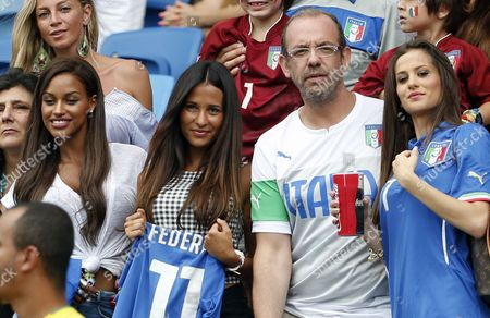 Stock Picture of Valentina Baldini (top L) Girlfriend of Italy's Andrea Pirlo Fanny Neguesha Fiancee of Mario Balotelli (l-r) Federica Riccardi Girlfriend of Italy's Alessio Cerci Am Unidentified Man and Valentina Abate Wife of Italy's Ignazio Abate Smile on the Stands Prior the Fifa World Cup 2014 Group D Preliminary Round Match Between Italy and Uruguay at the Estadio Arena Das Dunas in Natal Brazil 24 June 2014 (restrictions Apply: Editorial Use Only not Used in Association with Any Commercial Entity - Images Must not Be Used in Any Form of Alert Service Or Push Service of Any Kind Including Via Mobile Alert Services Downloads to Mobile Devices Or Mms Messaging - Images Must Appear As Still Images and Must not Emulate Match Action Video Footage - No Alteration is Made to and No Text Or Image is Superimposed Over Any Published Image Which: (a) Intentionally Obscures Or Removes a Sponsor Identification Image; Or (b) Adds Or Overlays the Commercial Identification of Any Third Party Which is not Officially Associated with the Fifa World Cup) Brazil Natal