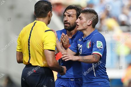 Italy's Andrea Pirlo (c) and Marco Verratti (r) Argue with Mexican Referee Marco Rodriguez (l) After He Sent Off Italy's Claudio Marchisio (not Pictured) During the Fifa World Cup 2014 Group D Preliminary Round Match Between Italy and Uruguay at the Estadio Arena Das Dunas in Natal Brazil 24 June 2014 (restrictions Apply: Editorial Use Only not Used in Association with Any Commercial Entity - Images Must not Be Used in Any Form of Alert Service Or Push Service of Any Kind Including Via Mobile Alert Services Downloads to Mobile Devices Or Mms Messaging - Images Must Appear As Still Images and Must not Emulate Match Action Video Footage - No Alteration is Made to and No Text Or Image is Superimposed Over Any Published Image Which: (a) Intentionally Obscures Or Removes a Sponsor Identification Image; Or (b) Adds Or Overlays the Commercial Identification of Any Third Party Which is not Officially Associated with the Fifa World Cup) Brazil Natal