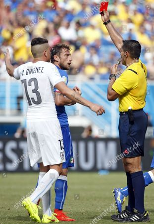 Mexican Referee Marco Rodriguez (r) Shows the Red Card and Sends Off Italy's Claudio Marchisio (c) During the Fifa World Cup 2014 Group D Preliminary Round Match Between Italy and Uruguay at the Estadio Arena Das Dunas in Natal Brazil 24 June 2014 (restrictions Apply: Editorial Use Only not Used in Association with Any Commercial Entity - Images Must not Be Used in Any Form of Alert Service Or Push Service of Any Kind Including Via Mobile Alert Services Downloads to Mobile Devices Or Mms Messaging - Images Must Appear As Still Images and Must not Emulate Match Action Video Footage - No Alteration is Made to and No Text Or Image is Superimposed Over Any Published Image Which: (a) Intentionally Obscures Or Removes a Sponsor Identification Image; Or (b) Adds Or Overlays the Commercial Identification of Any Third Party Which is not Officially Associated with the Fifa World Cup) Brazil Natal