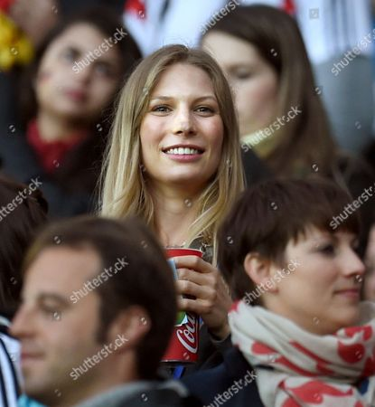 Sarah Brandner (c) Girlfriend of Germany's Bastian Schweinsteiger Cheers in the Stands During the Fifa World Cup 2014 Round of 16 Match Between Germany and Algeria at the Estadio Beira-rio in Porto Alegre Brazil 30 June 2014 (restrictions Apply: Editorial Use Only not Used in Association with Any Commercial Entity - Images Must not Be Used in Any Form of Alert Service Or Push Service of Any Kind Including Via Mobile Alert Services Downloads to Mobile Devices Or Mms Messaging - Images Must Appear As Still Images and Must not Emulate Match Action Video Footage - No Alteration is Made to and No Text Or Image is Superimposed Over Any Published Image Which: (a) Intentionally Obscures Or Removes a Sponsor Identification Image; Or (b) Adds Or Overlays the Commercial Identification of Any Third Party Which is not Officially Associated with the Fifa World Cup) Brazil Porto Alegre