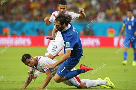 Costa Rica's Michael Umana (l) and Greece's Georgios Samaras (r) Vie Fro the Ball During the Fifa World Cup 2014 Round of 16 Match Between Costa Rica and Greece at the Arena Pernambuco in Recife Brazil 29 June 2014 (restrictions Apply: Editorial Use Only not Used in Association with Any Commercial Entity - Images Must not Be Used in Any Form of Alert Service Or Push Service of Any Kind Including Via Mobile Alert Services Downloads to Mobile Devices Or Mms Messaging - Images Must Appear As Still Images and Must not Emulate Match Action Video Footage - No Alteration is Made to and No Text Or Image is Superimposed Over Any Published Image Which: (a) Intentionally Obscures Or Removes a Sponsor Identification Image; Or (b) Adds Or Overlays the Commercial Identification of Any Third Party Which is not Officially Associated with the Fifa World Cup) Brazil Recife