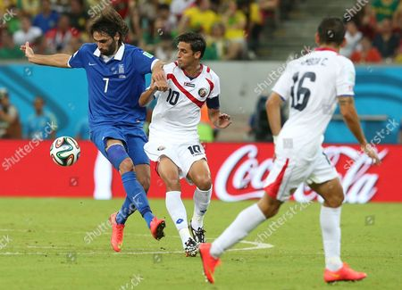 Greece's Georgios Samaras (l) and Costa Rica's Bryan Ruiz (c) Vie For the Ball During the Fifa World Cup 2014 Round of 16 Match Between Costa Rica and Greece at the Arena Pernambuco in Recife Brazil 29 June 2014 (restrictions Apply: Editorial Use Only not Used in Association with Any Commercial Entity - Images Must not Be Used in Any Form of Alert Service Or Push Service of Any Kind Including Via Mobile Alert Services Downloads to Mobile Devices Or Mms Messaging - Images Must Appear As Still Images and Must not Emulate Match Action Video Footage - No Alteration is Made to and No Text Or Image is Superimposed Over Any Published Image Which: (a) Intentionally Obscures Or Removes a Sponsor Identification Image; Or (b) Adds Or Overlays the Commercial Identification of Any Third Party Which is not Officially Associated with the Fifa World Cup) Brazil Recife