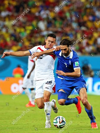 Costa Rica's Jose Cubero (l) and Greece's Georgios Samaras (r) Vie For the Ball During the Fifa World Cup 2014 Round of 16 Match Between Costa Rica and Greece at the Arena Pernambuco in Recife Brazil 29 June 2014 (restrictions Apply: Editorial Use Only not Used in Association with Any Commercial Entity - Images Must not Be Used in Any Form of Alert Service Or Push Service of Any Kind Including Via Mobile Alert Services Downloads to Mobile Devices Or Mms Messaging - Images Must Appear As Still Images and Must not Emulate Match Action Video Footage - No Alteration is Made to and No Text Or Image is Superimposed Over Any Published Image Which: (a) Intentionally Obscures Or Removes a Sponsor Identification Image; Or (b) Adds Or Overlays the Commercial Identification of Any Third Party Which is not Officially Associated with the Fifa World Cup) Brazil Recife
