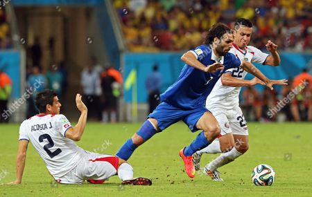 Greece's Georgios Samaras (c) Tries to Escape From Costa Rica's Johnny Acosta (l) and Jose Cubero (r) During the Fifa World Cup 2014 Round of 16 Match Between Costa Rica and Greece at the Arena Pernambuco in Recife Brazil 29 June 2014 (restrictions Apply: Editorial Use Only not Used in Association with Any Commercial Entity - Images Must not Be Used in Any Form of Alert Service Or Push Service of Any Kind Including Via Mobile Alert Services Downloads to Mobile Devices Or Mms Messaging - Images Must Appear As Still Images and Must not Emulate Match Action Video Footage - No Alteration is Made to and No Text Or Image is Superimposed Over Any Published Image Which: (a) Intentionally Obscures Or Removes a Sponsor Identification Image; Or (b) Adds Or Overlays the Commercial Identification of Any Third Party Which is not Officially Associated with the Fifa World Cup) Brazil Recife