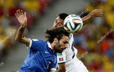 Georgios Samaras (l) of Greece Vies with Joel Campbell of Costa Rica During the Fifa World Cup 2014 Round of 16 Match Between Costa Rica and Greece at the Arena Pernambuco in Recife Brazil 29 June 2014 (restrictions Apply: Editorial Use Only not Used in Association with Any Commercial Entity - Images Must not Be Used in Any Form of Alert Service Or Push Service of Any Kind Including Via Mobile Alert Services Downloads to Mobile Devices Or Mms Messaging - Images Must Appear As Still Images and Must not Emulate Match Action Video Footage - No Alteration is Made to and No Text Or Image is Superimposed Over Any Published Image Which: (a) Intentionally Obscures Or Removes a Sponsor Identification Image; Or (b) Adds Or Overlays the Commercial Identification of Any Third Party Which is not Officially Associated with the Fifa World Cup) Brazil Recife