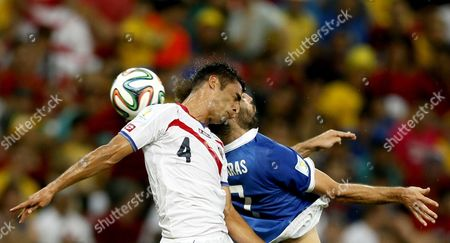 Michael Umana (l) of Costa Rica Vies with Georgios Samaras of Greece During the Fifa World Cup 2014 Round of 16 Match Between Costa Rica and Greece at the Arena Pernambuco in Recife Brazil 29 June 2014 (restrictions Apply: Editorial Use Only not Used in Association with Any Commercial Entity - Images Must not Be Used in Any Form of Alert Service Or Push Service of Any Kind Including Via Mobile Alert Services Downloads to Mobile Devices Or Mms Messaging - Images Must Appear As Still Images and Must not Emulate Match Action Video Footage - No Alteration is Made to and No Text Or Image is Superimposed Over Any Published Image Which: (a) Intentionally Obscures Or Removes a Sponsor Identification Image; Or (b) Adds Or Overlays the Commercial Identification of Any Third Party Which is not Officially Associated with the Fifa World Cup) Brazil Recife