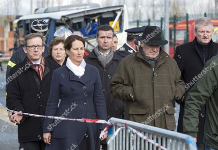 French Minister of Ecology and Transport Segolene Royal (2-l) Flanked by Dominique Bussereau (2-r) and Olivier Falorni (r) Visits the Site of a Bus Accident in Rochefort Near La Rochelle Southwest France 11 February 2016 Six Students Were Killed when Part of a Truck Hit the School Bus They Were Travelling in the Accident Took Place when Part of the Truck's Equipment Swung out and Struck the Side of the School Bus Eighteen Students Were in the Bus According to a Provisional Count by the Elysee Palace Three Students Were Injured It Said France Rochefort