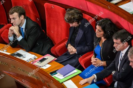 French Economy Minister Emmanuel Macron (l) Health Minister Marisol Touraine (2-l) Labor Minister Myriam El Khomry (2-r) and Prime Minister Manuel Valls (r) Attend the 4th Social Conference on Employment at the French Economic Social and Environmental Council (cese) in Paris France 19 October 2015 the Biggest Labor Union Cgt Boycotts the Meeting After Social Incidents at the French Airline Company Air France France Paris