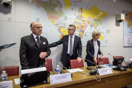 French Interior Minister Bernard Cazeneuve (l) German Interior Minister Thomas De Maiziere (c) and the President of the Commission Elisabeth Guigou (r) Arrive at Their Joint Audition by the French National Assembly's Foreign Affairs Commission in Paris France 15 June 2016 France Paris