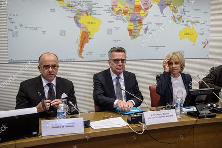 French Interior Minister Bernard Cazeneuve (l) German Interior Minister Thomas De Maiziere (c) and the President of the Commission Elisabeth Guigou (r) Attend Their Joint Audition by the French National Assembly's Foreign Affairs Commission in Paris France 15 June 2016 France Paris