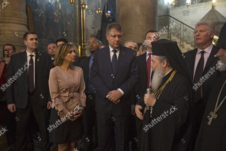 Romanian President Klaus Iohannis (c) and His Wife Carmen Johannis (c-l) During Their Visit to the Church of the Holy Sepulcher in the Old City of Jerusalem 07 March 2016 Iohannis is on an Official Visit to Israel and West Bank Israel Jerusalem