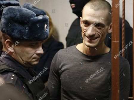 Russia's Political Performance Artist Pyotr Pavlensky (r) is Escorted to a Court Room at the Tagansky District Court in Moscow Russia 10 November 2015 a Criminal Case Has Been Opened Against Pavlensky who was Detained in Moscow After He Had Set Fire at the Door of Federal Security Service (fsb) Headquarters During His Action Under the Name of 'Threat' in the Early Hours of 09 November 2015 Russian Federation Moscow
