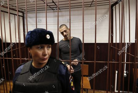 Russia's Political Performance Artist Pyotr Pavlensky (back) in a Cage at the Tagansky District Court in Moscow Russia 10 November 2015 a Criminal Case Has Been Opened Against Pavlensky who was Detained in Moscow After He Had Set Fire at the Door of Federal Security Service (fsb) Headquarters During His Action Under the Name of 'Threat' in the Early Hours of 09 November 2015 Russian Federation Moscow